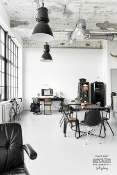 I'm a sucker for industrial windows with rustic furniture in a high ceiling, light-filled space