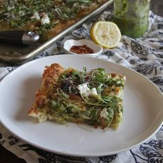 Asparagus & Leek Pizza // shutterbean. This is a great addition to the pizza-at-home repertoire. I left off the goat cheese and micro greens and it was still delicious.