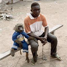 Dayaba Usman with the monkey Clear, Nigeria