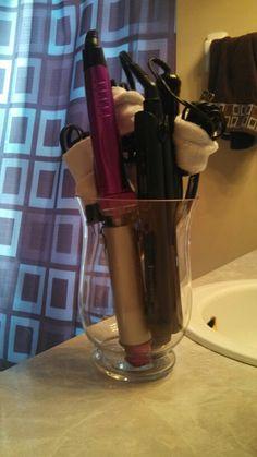 Flat iron/curling iron storage. Vase and sweat bands.