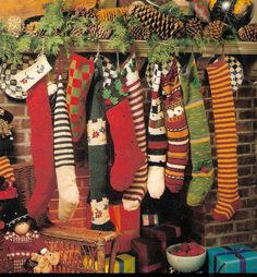 Chaming Old Fashion Christmas with the Mantle decorated with one of a kind hand knit Stockings, pine cones, pine greenery, etc.