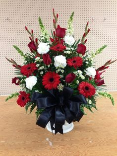 Alter arrangement church flowers red white and black gerber daisies roses Church Wedding Flowers, Funeral Flowers, Alter Flowers, Red Flowers, Funeral Flower Arrangements, Rose Arrangements, Memorial Flowers, Cemetery Flowers, Gerber Daisies