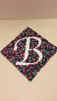 Initial canvas made with Mardi Gras beads! #DIY #Crafts