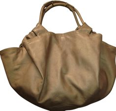 Loewe Lamb Skin Extra Soft Gold Tote Bag. Get one of the hottest styles of the season! The Loewe Lamb Skin Extra Soft Gold Tote Bag is a top 10 member favorite on Tradesy. Save on yours before they're sold out!