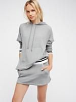 Play It Cool Set | Sporty meets femme with this so comfy co-ord featuring a relaxed pullover hoodie and cute micro mini.    * Contrast stripe detailing at the waistband and sleeve cuffs   * Hoodie features an athletic-inspired front pocket detail and subtle side vents   * Drawstring at the hood   * Mini features a wide waistband and side pockets