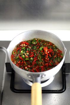 Makes: approx 2 cups The sauce may look universally deadly, but in fact, the spiciness can be easily adjusted by changing the ratio between large long red chilis (vibrant color and mildly spicy), long green chilis (fragrant and medium-spicy) and small Asian red... #chilisauce #chinese #condiments