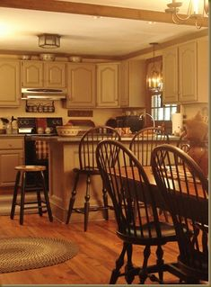 LOVE LOVE LOVE this kitchen!! One day I will have these windsor chairs and barstools...