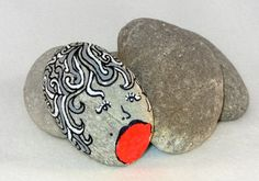 Handpainted river pebble with neon orange accent by DeGroeneBoon, €12.00