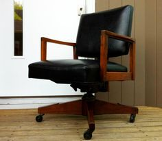 EXTRA EXECUTIVE: Vintage office furniture has migrated from the workplace (and probably dusty storage areas) to honored perches in home offices – like this Taylor Chair Company executive desk chair in black leather with walnut frame.