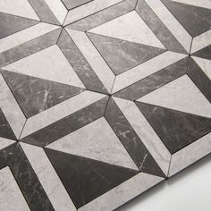 Inspired by the architecture of New York, the new Gramercy Park collection offers a versatile range of marble slab, tiles and décors. It includes contemporary marble tiles in eye-catching geometric patterns alongside plain honed surfaces. Available in a palette of 3 colourways – ivory, soft grey and veined black, the collection is designed as a suite of surfaces to be used in combination or individually. Slab options, ideal for skirtings, architraves, vanities and shower trays also available. Black Marble Tile, Marble Tiles, Gramercy Park, St James' Park, Architrave, Geometric Patterns, Palette, Contemporary, Shower Trays