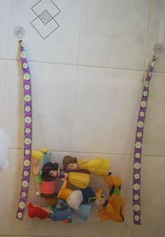 DIY Bath Toy Net: she bought net fabric near the tulle at the fabric store, used suction cups she already had...