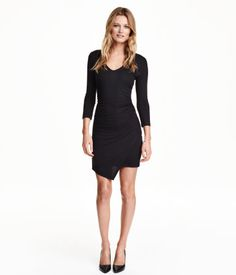 Fitted dress in soft jersey with a gentle drape. V-neck, 3/4-length sleeves, and draped, wrap-front skirt. Unlined.