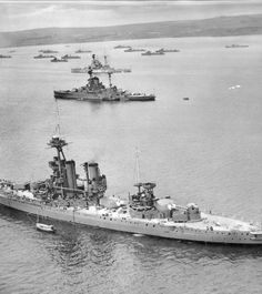 HMS Iron Duke, 1939 at Scapa Flow as a depot/AA ship. Two R class battleships, one possibly HMS Royal Oak, in the background.