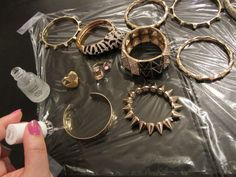 Paint your cheap costume jewelry with clear nail polish to keep it from tarnishing.