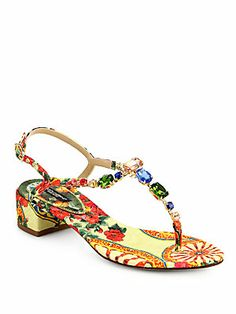 """Dolce & Gabbana Jeweled Floral-Print Block-Heel Sandals $795.00     Rainbow-hued rhinestones shimmer on a T-strap silhouette in luxurious canvas with a fanciful print.      Self-covered heel, 1½"""" (40mm)     Rhinestone-encrusted canvas upper     Adjustable ankle strap     Leather lining and sole     Padded insole     Made in Italy."""