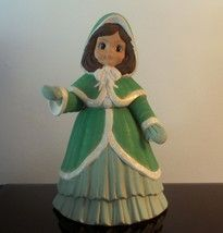 Vintage Christmas Caroler Hollie     Beautiful Bisque Christmas Caroler   From the Sugarplum Collectin  Features a young girl with brown hair.                 The girl wears a green hooded cape over top of a green gown.  She has brown hair and big eyes.  Stands 12 inches high by 8 inches wide.