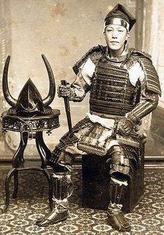 Samurai wearing full armor including kokake (armored foot coverings).