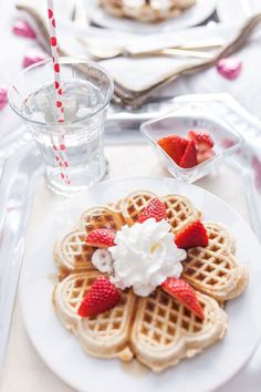 Waffles with whipped cream and strawberries for Valentine's Day Breakfast in bed by Fashionable Hostess