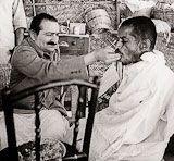 Meher Baba feeding Mohammed.