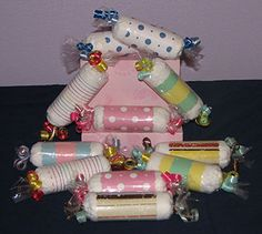 """Baby Shower Favors Diaper Candy~Each Candy Consists of:  1- Pampers Swaddlers Diaper  Rolled and Wrapped with Themed Card Stock & Tied at Each End With Colored Ribbon.The candy measures 6""""L x 2""""W."""