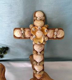 Sea shell decorated cross_beach decor by CarmelasCoastalCraft