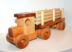 Old Timie log truck with removable trailer and logs by Frozen Creek Woodworks, via Flickr