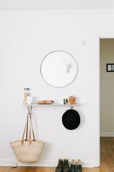 Round mirror, simple shelf with brackets that also serve as hooks | No Entryway, No Problem: 50 Solutions for Small Spaces