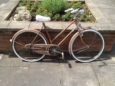 """""""Shabby Sleek"""" this Raleigh rod brake bike's main feature is the rust look patina finish. Combined with clean, off white extras provides the shabby but sleek look.  Email mcsimsi@hotmail.co.uk for more info"""