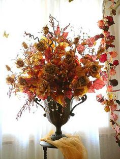 Thanksgiving table decorating with a floral arrangement enhances the spirit of…