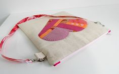 Samantha from At Home with Mrs. H is an independent pattern designer, living in Wales.  This is a CUTE little bag!