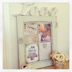 An old cabinet door painted in my homemade chalkpaint & transformed into a gorgeous picture frame with love script attached to the top