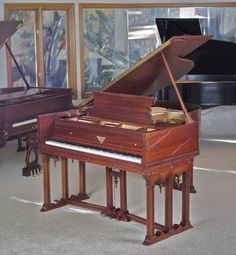 Fully restored - This beautiful one of kind satin Mahogany JC Fischer, Frank Lloyd Wright, 88 note piano was made in 1927. The detail is exquisite on this piano. Truly iconic style of Frank Lloyd Wright with a rich tone and unique appeal. It has an equally detailed cushioned bench. The size of piano is a 5'8 so it can be easily put into any size room of your home. Serial # 155701. It has Piano Disc player piano system installed. Imagine a dinner party with music playing in the background…