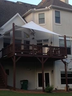 Privacy shade on our deck, extend upright posts, attach sail shade