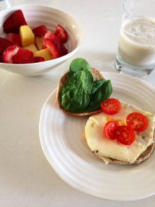 Wholesome Breakfast: Crispy Egg Sandwich with Fruit--HealthyFoodFuel