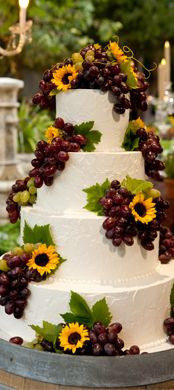 grapes and sunflowers on this Tuscany / Napa Valley / Wine Country themed cake