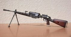 Italian Breda Model 30 light machine gun.  It was the standardRoyal Italian Army light machine gun in WW 2. Cal.6.5x52mm Mannlicher-Carcano.  Variants Breda M37. Cal. 7.65.