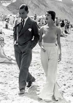 beach glamour- Love the pants and tank. He looks marvelous too.