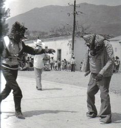 "Jaguars in fierce combat during the celebration for the feast of the Holy Cross.  Zitlala, Guerrero (Nahua), 1987.    Photo: Ruth D. Lechuga from the book  ""Tigers, Devils, and the Dance of Life - Masks of Mexico"" by Barbara Mauldin"