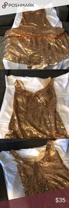 Dress This gold dress look very nice on has a bustle the photo on is with bustle up worn one time my daughter  is an 8 so I'm sizing as such she had it bigger so thinking was a 10 Dresses Prom