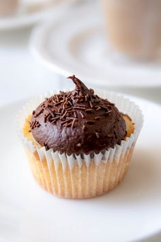 vanilla cupcakes with chocOlate buttercream frosting