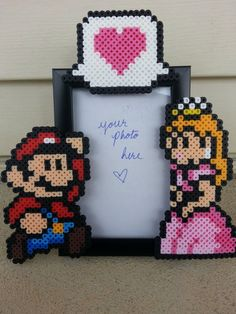Mario and Princess Peach Picture Frame - Couples Picture Frame - Nerdy Anniversary Gift - Nerdy Wedding Gift - Video Game Wedding - Perler Beads (Bügelperlen) - Perler Bead Templates, Diy Perler Beads, Pixel Beads, Fuse Beads, Hama Beads Patterns, Beading Patterns, Mario And Princess Peach, Perler Bead Mario, Little Presents