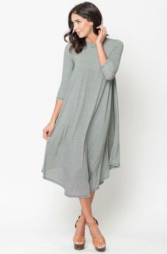 New-favorite-dress alert! A charming everyday must-have. With its flattering A-line, leg lengthening silhouette, mixed in with classic stripes, this soft jersey design combines the ease of a tee with the versatility of a dress.