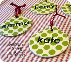 Mod Podged Ornaments ITEMS YOU NEED: wooden ornaments spray paint, or craft paint scrapbook paper mod podge and foam brush ribbon vinyl lettering, or other embellishments (Christmas shapes, etc. Homemade Ornaments, Wooden Ornaments, Homemade Gifts, Xmas Ornaments, Personalized Ornaments, Homemade Christmas, Paper Ornaments, Frugal Christmas, Christmas Ornaments For Students