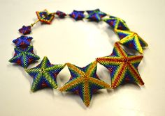 Pam's glorious star necklace in a rainbow of colours - image copyright © Jean Power