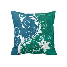 Blue, green and white floral throw pillow produced by sustainably employed single moms in the USA