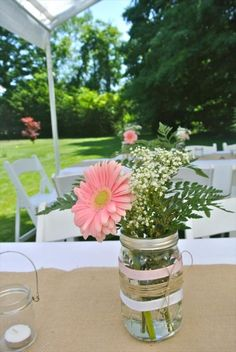 Pink Gerbera Daisy Centerpieces for our rustic country bridal shower. Mason jars decorated with lace, ribbon, and burlap filled with pink gerber daisies, white daisies, and babies breath! Daisy Centerpieces, Bridal Shower Centerpieces, Centerpiece Ideas, Mason Jar Flower Arrangements, Cheap Mason Jars, Mason Jar Diy, Bridal Shower Rustic, Rustic Wedding, Trendy Wedding