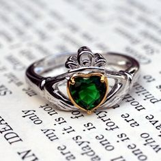 Our Emerald Claddagh Heart Ring is brilliant. The story of the Claddagh is so romantic. Long ago a young man was captured and sold into slavery from the fishing village of Claddagh. Many years passed and he wondered if his true love would wait for him. Over the years he stole tiny bits of gold from his master to make her a ring. He fashioned a heart for love, a crown for loyalty and hands as a symbol of friendship. After many years he finally returned home to Claddagh. Upon his return and to…