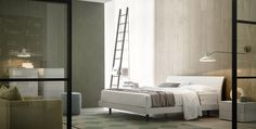 Bend, Beds, Products | The combination of the arched Bend headboard and the bed frame with rounded corners, creates a harmonious and balanced composition, in tune both with a modern bedroom and a more traditional architecture and style of furnishing. Bend is designed by Nova Lab for #novamobili. #bed #design #bedroom #aboutNIGHT