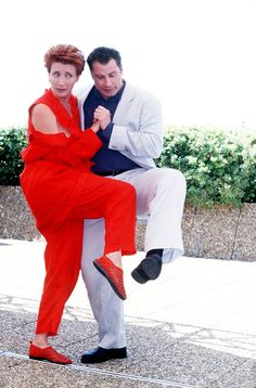 Pin for Later: 53 Cannes Film Festival Photos That Will Take You Way, Way Back  Emma Thompson and John Travolta did a funny dance in 1998.