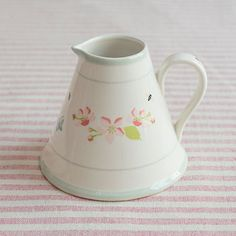 Our pretty Apple Blossom Baby Pitcher is perfect for serving milk for afternoon tea or even displaying flowers this spring